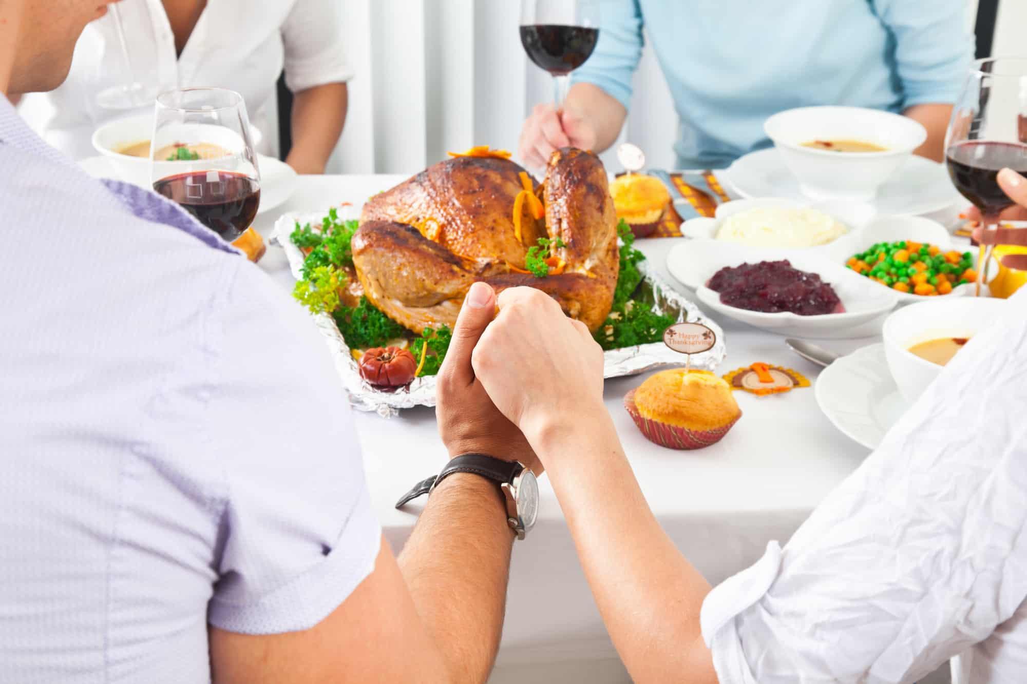 Thanksgiving family prayer around table