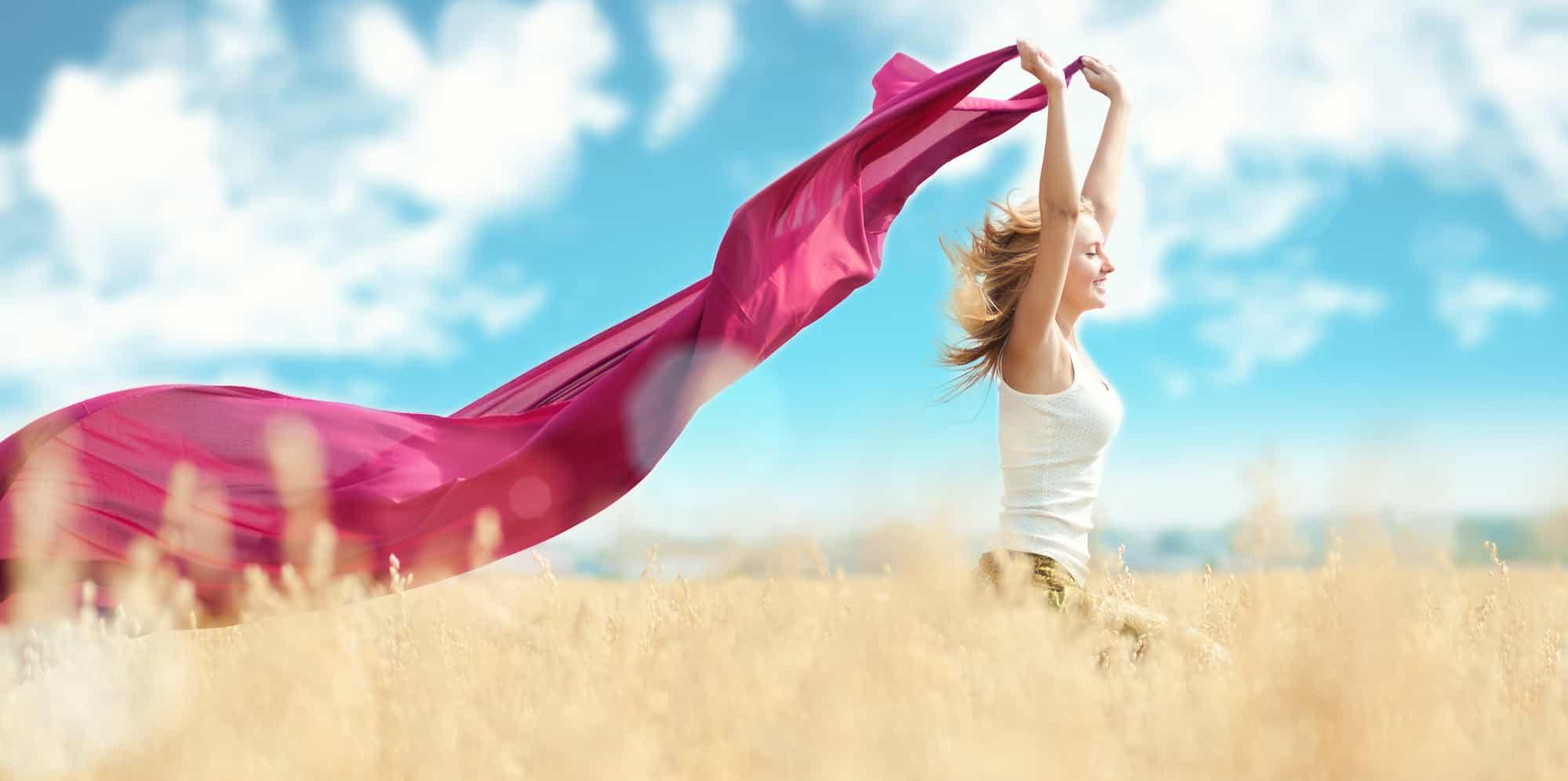 Happy woman on picnic in wheat field