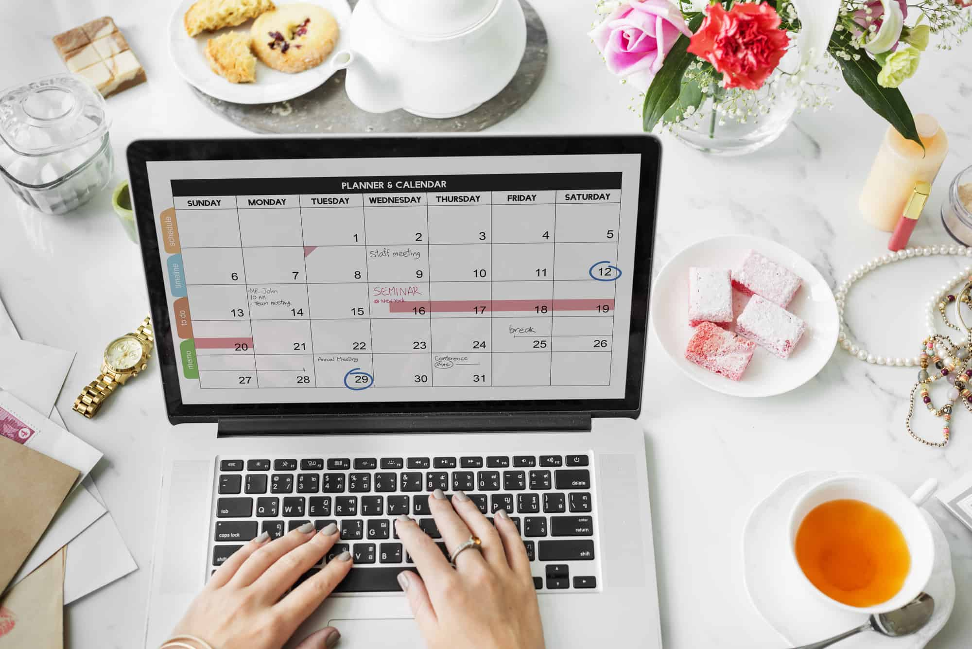 Woman looking at schedule on laptop