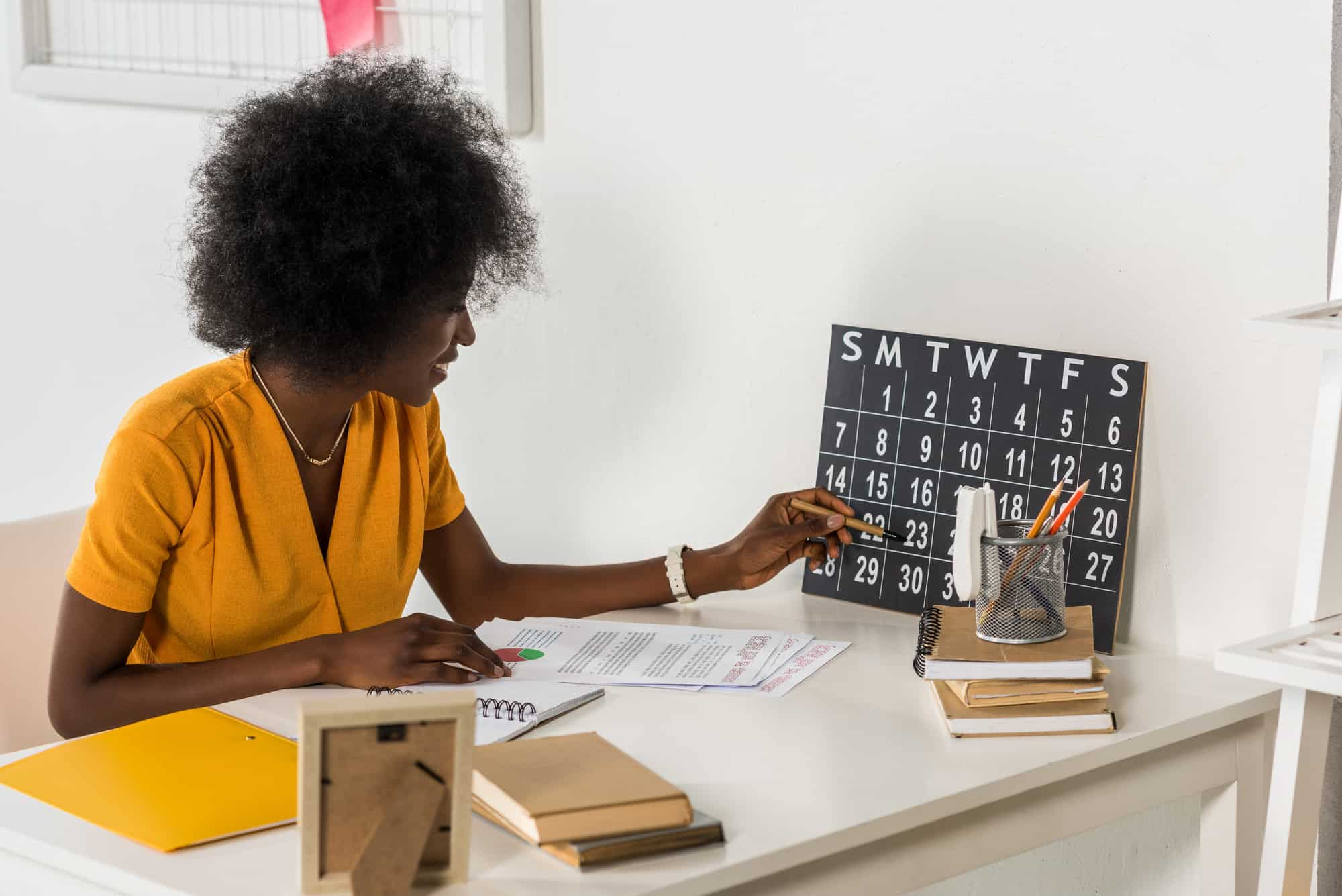 Woman checking calendar at workplace at home office